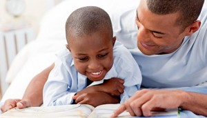 dad-son-reading-300x171-resized-600
